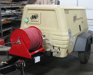 Portable Air Compressor With a Hose Reel Attached